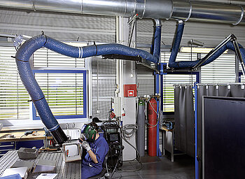 Fume extraction system for a welding bay